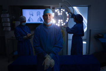 Male surgeon standing at operation theater