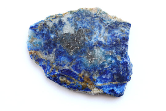 Lapis lazuli stone tile top view on white background