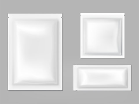 Blank white sachets for wet wipes, sauces or spices, easy tear sealed, rectangular plastic, foil or polythene packets isolated 3d realistic vector illustration. Food products airtight packaging mockup