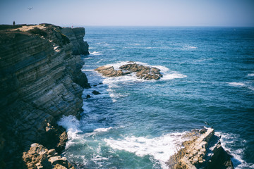 Wall Mural - Beautiful seascape, Porugal, shore of the Atlantic Ocean, waves and rocks, retro tone