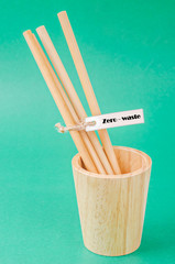 Bamboo drinking straws and wooden glass with Zero - waste.