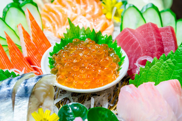 Ikura (salmon roe) in sashimi set.