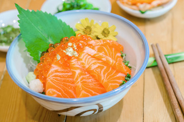 Salmon sashimi with salmon's egg (Ikura) in bowl.