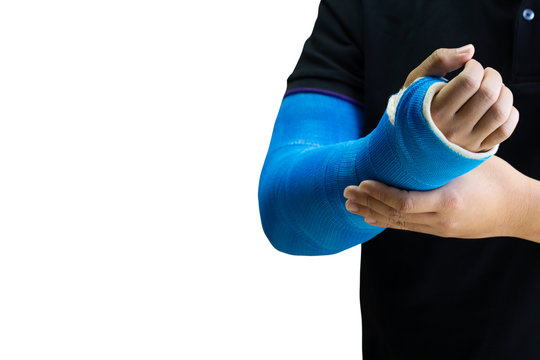 man holding hand with blue bandage as arm injury concept.