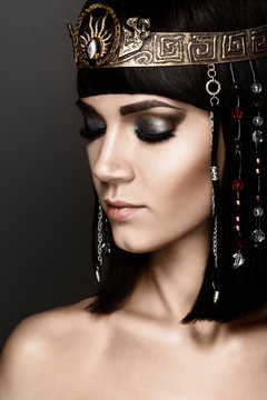 Close-up portrait of beautiful woman with bright make-up. Cleopatra