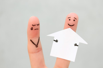 Finger art of family during quarrel. Concept of man and woman divide house after divorce.