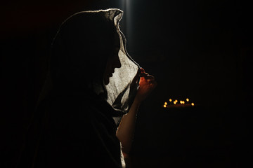 Silhouette of woman in veil