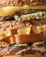 Macro photo of slices of bread with sesame seeds and cheese. Healthy snack.