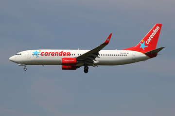 LIJNDEN, THE NETHERLANDS - June 25, 2015: Corendon Dutch Airlines Boeing 737-800 with registration PH-CDF on short final for runway 18C of Amsterdam Airport Schiphol.