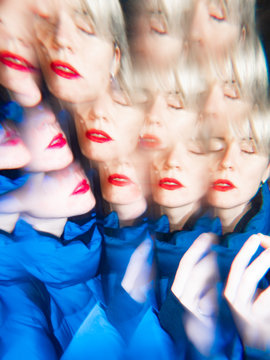 Surreal image of a fashionable woman with red lipstick