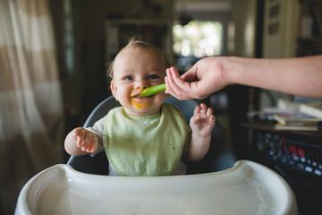 Happy baby food grin