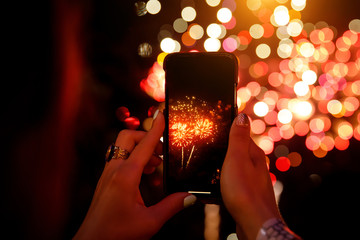 shoots fireworks video on smartphone.
