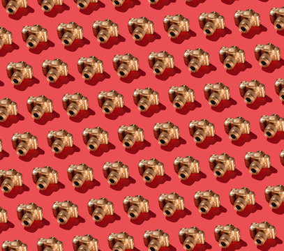 Golden SLR Camera on Bright Red