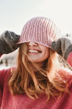 Cheerful woman in winter sun