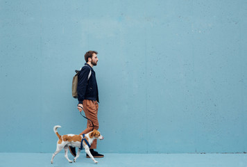 Man walking the dog against the blue background