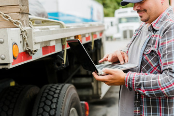 Trucker using laptop