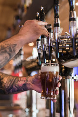 Bartender Pours Draft Beer Into Glass