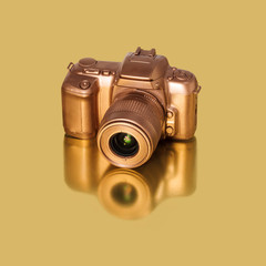 Golden SLR Camera on Gold