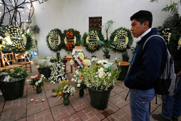 A man stands next to the memorial for late Mexican graphic artist Francisco Toledo at the Graphic Arts Institute of Oaxaca (IAGO) in Oaxaca