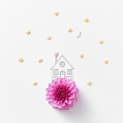 Natural pink flower drawn in a linear handle with a house around