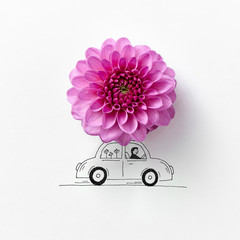 Drawing auto decorated with colorful pink flower on gray backgro