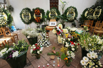 A picture of late Mexican graphic artist Francisco Toledo is seen next to wreaths and flowers at his memorial at the Graphic Arts Institute of Oaxaca (IAGO), in Oaxaca