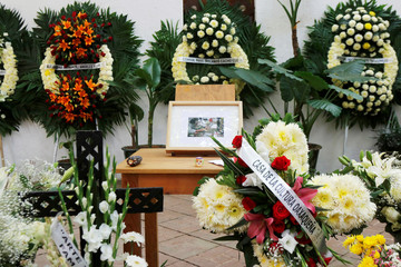 A picture of late Mexican graphic artist Francisco Toledo is seen next to wreaths at his memorial at the Graphic Arts Institute of Oaxaca (IAGO) in Oaxaca