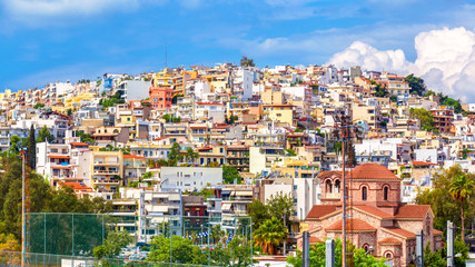 Fototapete - Panoramic view of Piraeus near Athens, Greece. Cityscape of Piraeus with colorful houses. Scenery of Greek city on hill in summer. Concept of travel and vacation in Greece.
