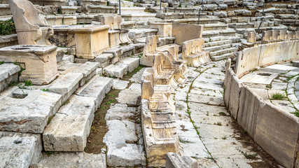 Fototapete - Theatre of Dionysus at the foot of Acropolis, Athens, Greece. It is one of the top landmarks in Athens. Detail of the famous outdoor theatre with stone seats. Ancient Greek ruins in Athens center.