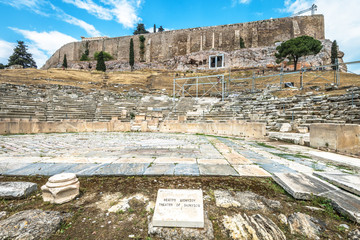 Fototapete - Theater of Dionysus at the foot of Acropolis, Athens, Greece. It is one of the main landmarks in Athens. Panorama of the Ancient Greek ruins in Athens center. Scenic great remains of old Athens city.