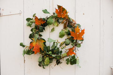 fall wreath on a white barn door