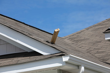 A piece of framing lumber from a nearby destroyed home that became a projectile and pierced an adjacent house's roof is seen after a tornado spawned by Hurricane Dorian ripped through Carolina Shores, North Carolina