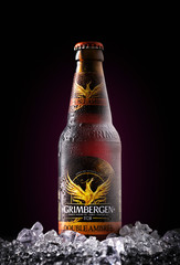 MINSK, BELARUS - APRIL 17, 2019: Bottles of Grimbergen Double Ambree beer with ice and drops.