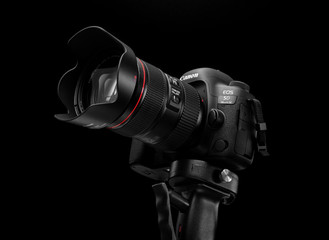 Tel-Aviv, ISRAEL - DECEMBER 05, 2017: Canon 5D Mark IV camera with Canon EF 24-105mm f/4L II USM lens on a black background. Canon is the world largest SLR camera manufacturer.