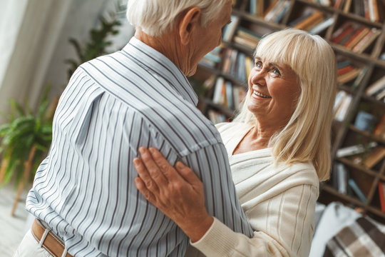 Senior couple together at home retirement concept dancing ballroom dance happy close-up