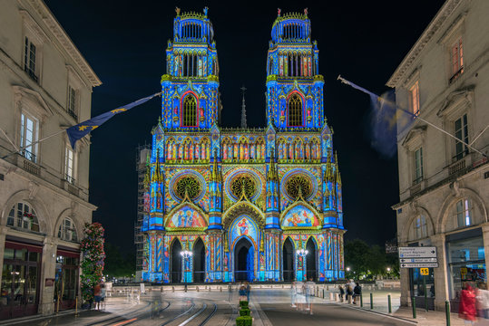 Joanna of Arc street that flows into the Church of the Holy Cross in Orleans, France. Illuminated with the technique called maping
