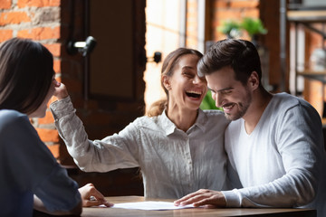 Happy couple making successful deal in cafe, purchase real estate