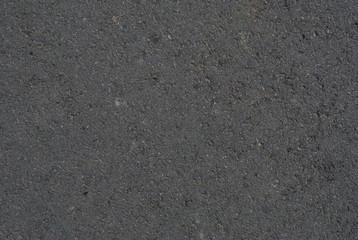 Smooth asphalt road. Tarmac dark grey grainy road background. Top view grunge rough surface