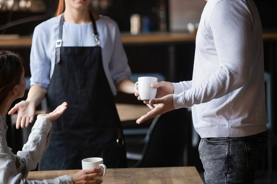 Close up outraged customers arguing with waitress, bad service concept