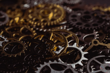 From above technical texture of steampunk gears on dark brown background
