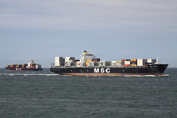 MAASVLAKTE/ ROTTERDAM, THE NETHERLANDS - August 16, 2013: MSC SORAYA and MSC CLAUDIA at Sea. MSC is the world's second-largest shipping line in terms of container vessel capacity.