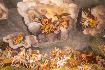Old medieval italian fresco showing battle in heavens and on earth