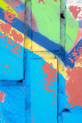Abstract street art pattern. Weathered graffiti wall background. Grunge painted texture. Old paint surface.