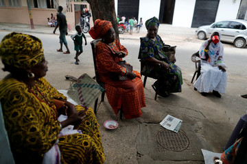 Women enjoy their late afternoon as they sit outside their house in Medina neighbourhood