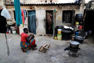 A woman combs her daughter's hair in Medina neighbourhood, Dakar