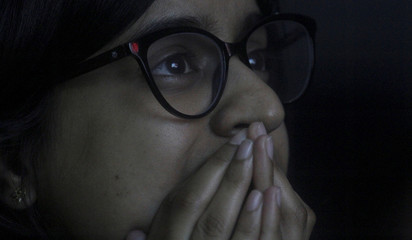 A student reacts as she watches a live stream of Chandrayaan-2 landing at an educational institute in Mumbai