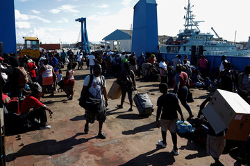 People get in a ferry at Marsh Harbour Government Port during an evacuation operation after Hurricane Dorian hit the Abaco Islands in Marsh Harbour