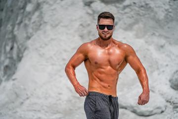 Printed kitchen splashbacks Artist KB Professional bodybuilder posing. Concept of sport outdoors.