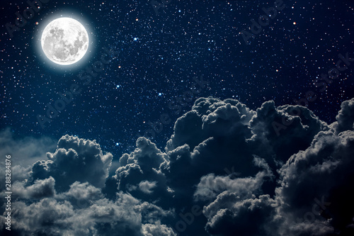 Wall mural backgrounds night sky with stars and moon and clouds.