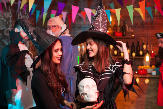 Beautiful witches looking at eachother at halloween celebration